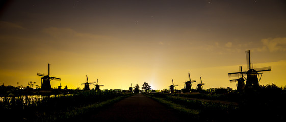 Picturesque landscape with windmills