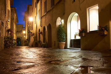 Illuminated Street of Pienza after rain at Night, Italy