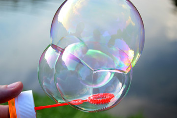 Three soap bubbles connected to each other
