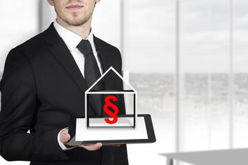 businessman holding tablet pc paragraph
