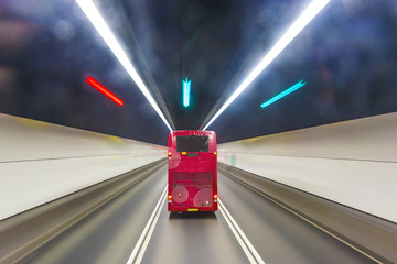 red english bus in a tunnel in Hongkong