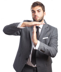 business man doing break symbol on a white background