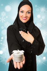 Arabic woman, holding Christmas present box.
