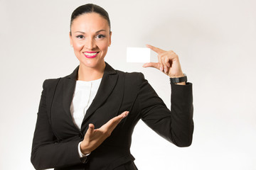 Business woman,smiling to the camera,holding white card.