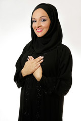 Arab woman,traditionally dressed,smiling with hands crossed