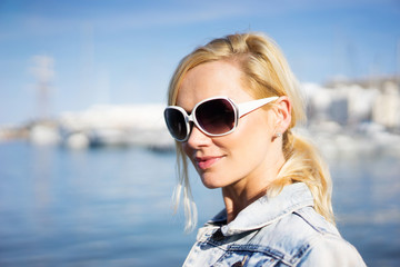 Beautiful natural young blond woman in sunglasses