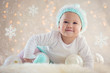Winter Baby Smiling With Christmas Ornaments