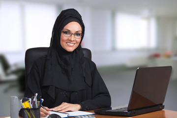 Young Arabic business woman,working in her office.