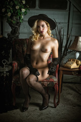 Elegant Nude Blond Woman in Fishnets and Gloves