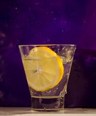 Lemon in glass after splash