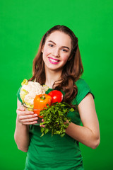 close up portrait of young woman with vegetables.