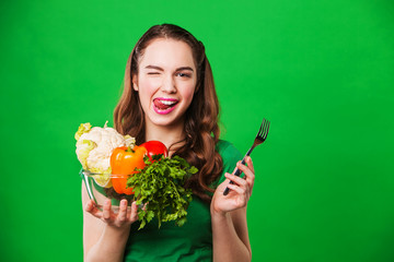 beautiful woman holding vegetables for salad