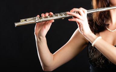 Art. Hands of flutist flaustist musician playing flute