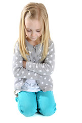 cute girl kneeling down arms folded eyes closed to pray