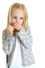 cute young girl holding her nose bad smell