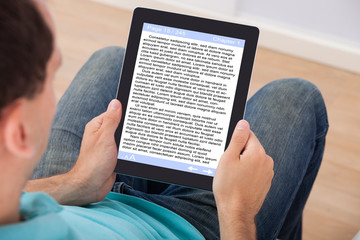 Man Reading eBook At Home