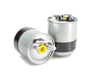 Two metal fuel filters isolated on white