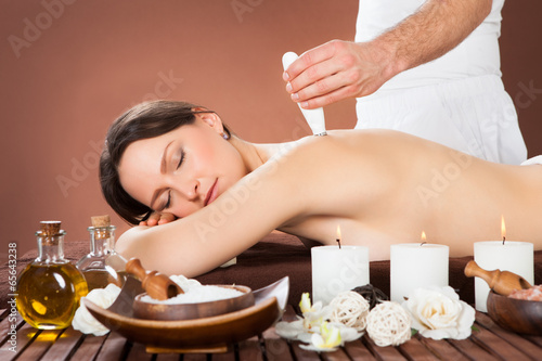 poster of Woman Receiving Microdermabrasion Therapy At Beauty Spa