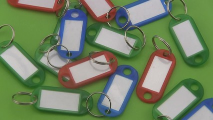 Coloured  key tags rotating on a green background.