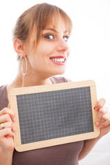 Happy young woman with small blackboard