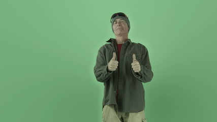 Senior caucasian outdoorsy man isolated on chroma green screen