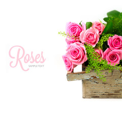 Rose flowers bouquet in wooden box on white background