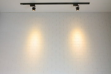 white brick wall with track  light