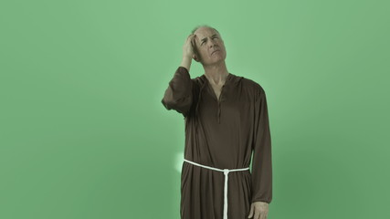 Senior caucasian monk isolated on chroma green screen thinking