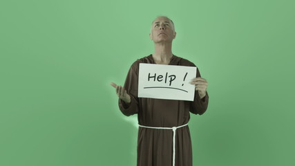 Senior caucasian monk isolated on chroma green screen help sign