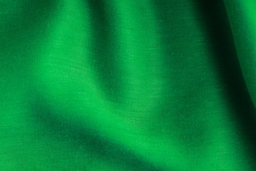 green background abstract cloth wavy folds of textile texture