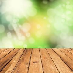 Vintage wooden planks over bokeh green background