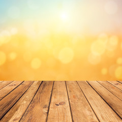 Vintage wooden planks over bokeh sunset background