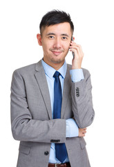Businessman answering smart phone