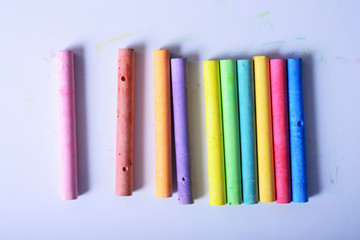 rainbow colored chalk arranged on a white background, chalk isol