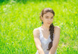 Portrait of a girl sitting on grass. Soft focus on eyes.