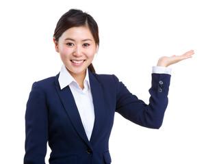 Smiling businesswoman showing something