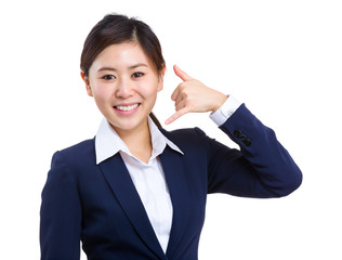 Business woman showing calling sign