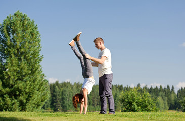 Young woman doing handstand outside