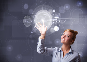 Attractive businesswoman touching abstract high technology circu