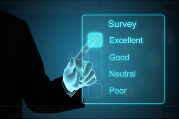business hand clicking survey on touch screen