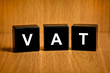 VAT or value added tax word on black block