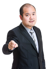 Angry businessman pointing to front