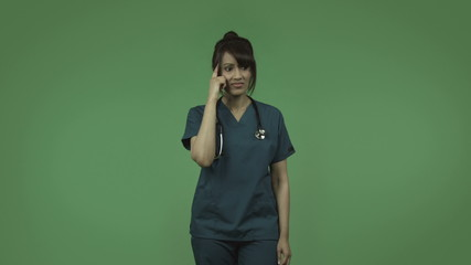 indian female doctor thinking and scratching head isolated on