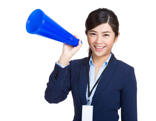Smiling business woman holding megaphone