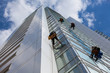 cleaning skyscrapers outside with a crane - window washing - 65653873