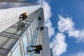 cleaning skyscrapers outside with a crane - window washing
