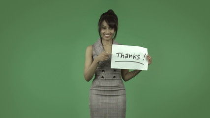 indian business woman isolated on green with thanks sign