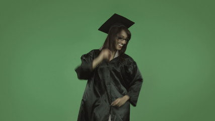 adult student graduate isolated on green happy dance