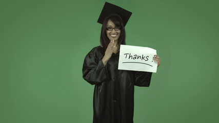 adult student graduate isolated on green with thanks sign