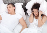 Fototapety  Snoring man and young woman. Couple sleeping in bed.